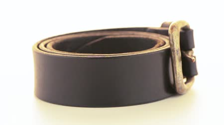přezka : Leather belt rotating on white background.