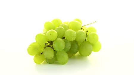 outlinable : Green grapes rotating on white background.
