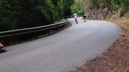 luge : PINHEIRO DA BEMPOSTA, PORTUGAL - AUGUST 9, 2014: Skateboard riders during the 2nd Newtons Force Festival 2014. Stock Footage