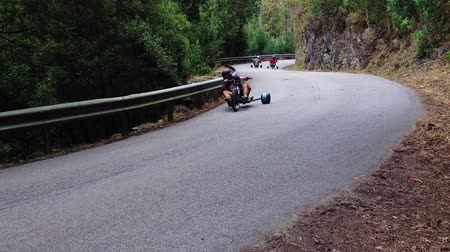 luge : PINHEIRO DA BEMPOSTA, PORTUGAL - AUGUST 9, 2014: Drift trike riders during the 2nd Newtons Force Festival 2014. Stock Footage