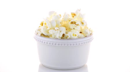 film festival : Popcorn in a white bowl on a white background Stock Footage