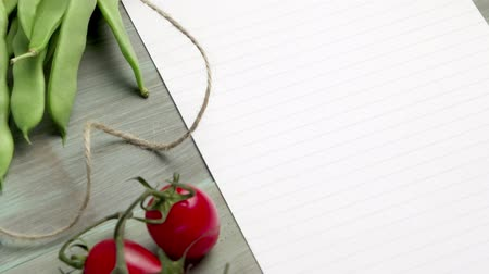 kitchen paper : Blank white paper and fresh colorful vegetables on kitchen table Stock Footage