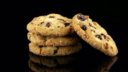 snack : Dried fruits chip cookies isolated on black background.