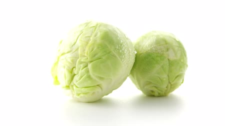 bakkal : Fresh brussels sprouts isolated on white background. Stok Video