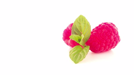 gourmet : Ripe raspberry with leaf isolated on white background. Stock Footage