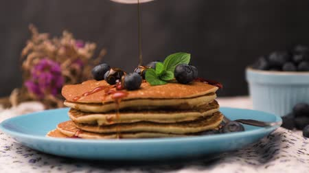 martwa natura : Delicious golden pancakes with fresh blackberries.