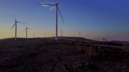 ветроэнергетики : Flight above wind turbines scenery at golden autumn sunset, aerial panoramic view in Aveiro, Portugal.
