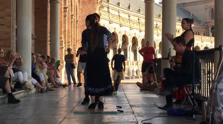 spanish style : SEVILLE, SPAIN - CIRCA OCTOBER 2017: Group of flamenco dancers in Plaza de Espana in Seville, Spain