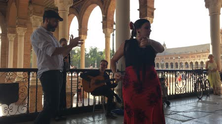 conta : SEVILLE, SPAIN - CIRCA OCTOBER 2017: Group of flamenco dancers in Plaza de Espana in Seville, Spain