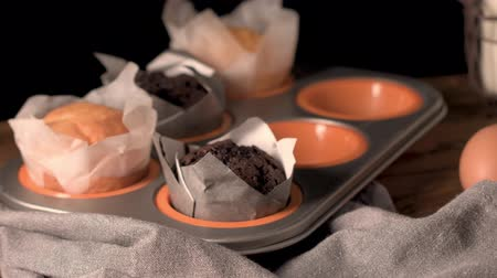 cakes : Homemade muffins with chocolate and baking ingredients. Stock Footage