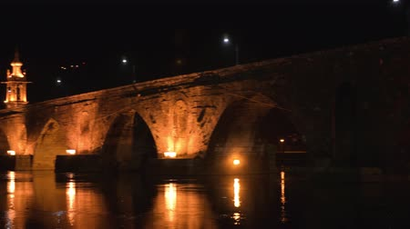 lima : Night view of Roman bridge crossing the Rio Lima in Ponte de Lima. Camino de Santiago - Portugal.