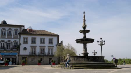 points of interest : PONTE DE LIMA, PORTUGAL - CIRCA APRIL 2018: The main square Largo de Camoes with the 18th Century fountain in Ponte de Lima, a town in the Northern Minho region in Portugal.