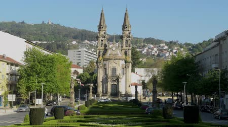 santos : GUIMARAES, PORTUGAL - CIRCA APRIL 2018: Church of Nossa Senhora da Oliveira in Guimaraes. The city was settled in the 9th century at which time it was called Vimaranes. Stock Footage