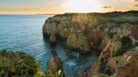 ponta da piedade : Sunset over the cliffs and beaches by Atlantic Ocean, Lagos, Algarve, Portugal. Stock Footage