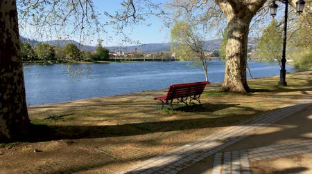 lima : Park bench in river side view in nature landscape, Ponte de Lima, Portugal.