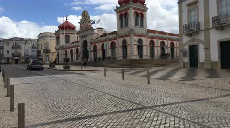 iberian : LOULE, PORTUGAL - CIRCA MAY 2018: Hyperlapse on the Clocks tower (Torrre do Relogio) near the city council in the old town of Loule at the Algarve, Portugal.