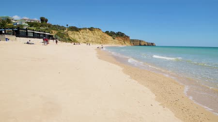 tyrkysový : LAGOS, PORTUGAL - CIRCA MAY 2018: Beautiful sandy beach near Lagos in Ponta da Piedade Algarve region Portugal.