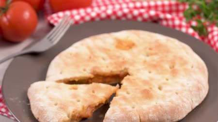 ham : Italian food, pizza calzone with tomato, spinach and cheese on wooden background.