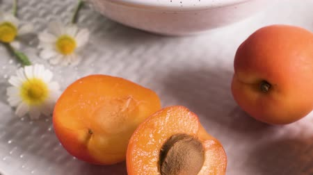 damascos : Delicious ripe apricots fruit on wooden background close up.