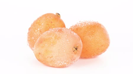 chlupatý : Three fresh orange Japanese loquats stack isolated on white background