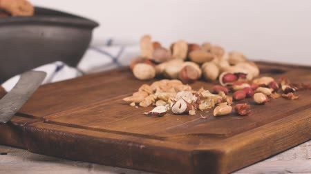 dilis : Walnuts, hazelnuts, peanuts and nuts on wooden table.