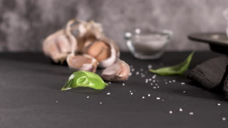 countertop : Garlic and fresh basil leaves on kitchen countertop. Concept of mediterranean traditional healthy food.
