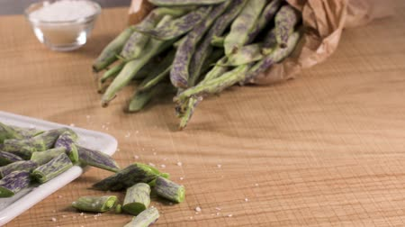 bekap : Heap of green beans on a rustic wooden table top view. Cutting board with green beans
