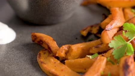 olivy : Crispy sweet potato fries in ceramic dish.