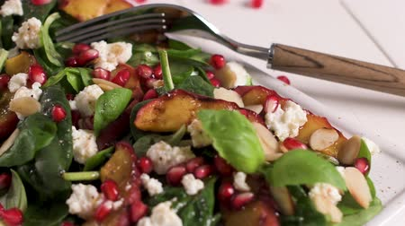 шпинат : Fresh vegetable salad with grilled peach, pomegranate, spinach and fresh cheese.
