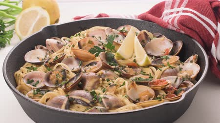 seafood recipe : Traditional italian seafood pasta with clams Spaghetti alle Vongole. Stock Footage