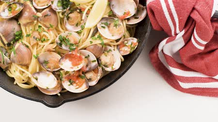 shellfish recipe : Traditional italian seafood pasta with clams Spaghetti alle Vongole. Stock Footage