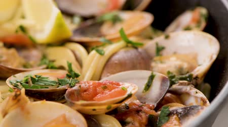 seafood dishes : Traditional italian seafood pasta with clams Spaghetti alle Vongole. Stock Footage