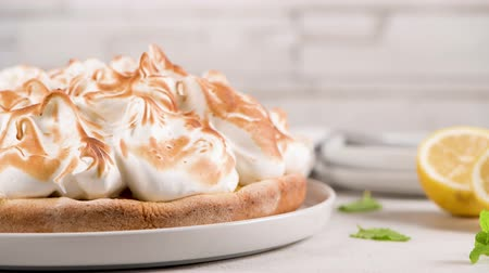 baked pudding : French tart with  Merengue on white wooden background. Pastry tasty homemade tart and pie with napkin.