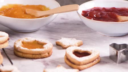 glazura : Homebaked Christmas Cookies With fruit Jam filling and Icing Sugar.
