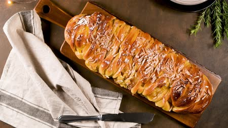 bread stick : Christmas braided cinnamon cake on festive table.
