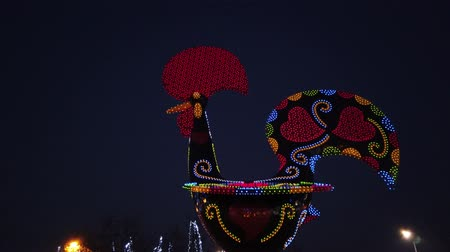 leds : BARCELOS, PORTUGAL - CIRCA JAUARY 2019: View at the Pop Galo at night, public art inspired in the Barcelos cock, cosidered one of the most important symbols of Portuguese popular culture.