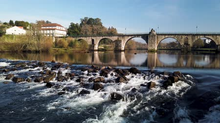 lima : Roman bridge in Ponte da Barca. Ponte da Barca belongs to the vinho verde demarcated wine region.