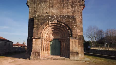 parrocchia : Front facade and decorated architrave of the thirteenth-century Romanesque Church Sao Salvador of Bravaes. Filmati Stock