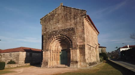 sao : Front facade and decorated architrave of the thirteenth-century Romanesque Church Sao Salvador of Bravaes. Stock Footage