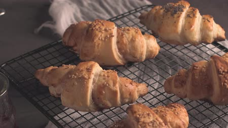 pronto a comer : Baked croissants with strawberry jam on a kitchen countertop. Stock Footage