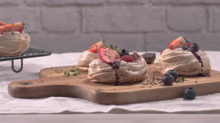 pavlova : Small pavlova cakes with fresh Strawberries and blueberries.