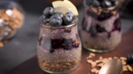 maia : Chia pudding with blueberries on dark table. Vídeos