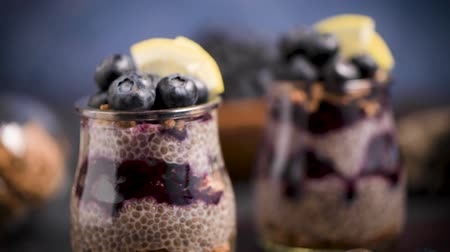 cold desert : Chia pudding with blueberries on dark table. Stock Footage