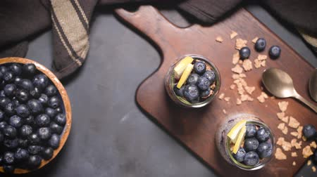 maya : Chia pudding with blueberries on dark table. Stok Video