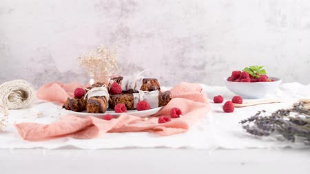 pinda s : Cereal bars with peanuts and chocolate with raspberries on kitchen counter top. Stockvideo