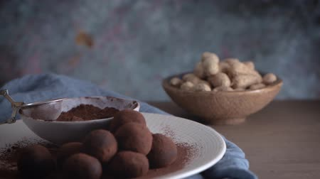 fıstık : Craft chocolate truffles on plate with cocoa powder and peanuts.