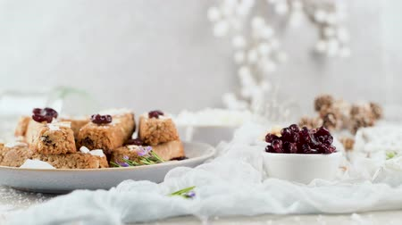 corn flakes : Cereal bars with almonds, coconut and cranberries on a Christmas season table decorated with lights and stars.