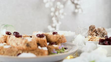 pinda s : Cereal bars with almonds, coconut and cranberries on a Christmas season table decorated with lights and stars.