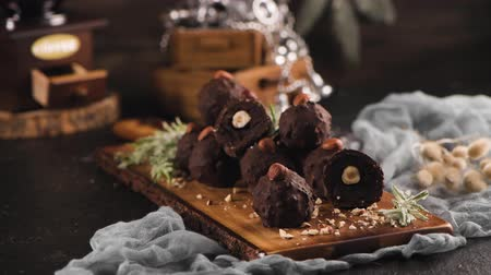 walnoot : Dark chocolate truffles with hazelnuts over wooden cutting board.