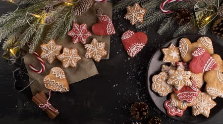 アイシング : Baked Christmas cookies on rustic dark background. 動画素材